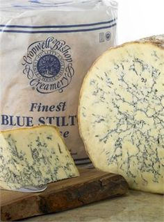 "Stilton is a cow's milk blue cheese from England.  This is England's only name protected cheese.  This pasteurized blue is full flavored, rich with a firm yet crumbly texture. Its blue veins speckle from a natural, crinkly brown crust.  Great to pair this cheese with sherry, port and most robust reds.  Stilton cheese is truly knows as the ""King of all cheeses"". $19/lb from Ideal Cheese Shop"
