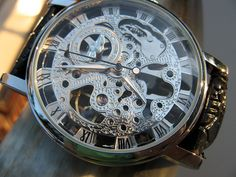 Hey, I found this really awesome Etsy listing at http://www.etsy.com/listing/109165199/silvertone-mechanical-wrist-watch-with