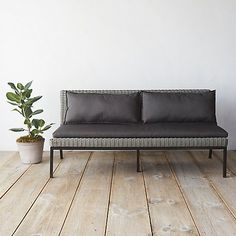 Modernist All Weather Wicker Sofa, $1498, Terrain