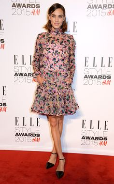 Alexa Chung at the 2015 Elle Style Awards in a colorful high collar floral print dress and black pointy d'orsay flats with ankle straps