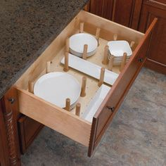 for RV campers to keep dishes organized and from sliding around during transport use a peg system.