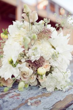 Hand-tied bouquet with dahlias, lisianthus, sedum, Queen Anne's lace & roses