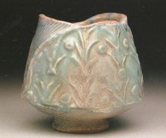 "Rachel Berg.  Moonlit garden sake cup, 2003.  2.5 x 2 x 2 in.  Thrown and hand built stoneware; soda fired, cone 10, impressed patterns.Photo by artist.  Featured in ""500 CUPS:  Ceramic Explorations of Utility & Grace"" (A Lake Ceramics Book) Paperback – February 1, 2005."