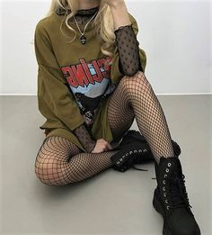 Necklace, oversized graphic tee, oversized fishnet stockings & boots