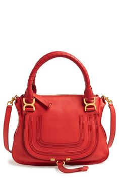 A red bag is always in style.