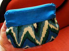 Turquoise Zig-Zag Essentials Bag. $8.99 USD, via Etsy.
