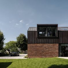 Villa IJsselzig by EVA Architecten is a riverside home featuring red-brick walls and a patinated copper roof Zinc Cladding, Brick Cladding, House Cladding, Exterior Cladding, Brick Facade, Zinc Roof, Copper Roof, Brick Architecture, Architecture Details