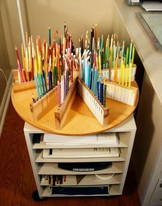 How to Organize Your Colored Pencil Collection DIY Lazy Susan Wooden Colored Pencil Holder: Create your own colored pencil caddy with a little woodworking magic. You can even put a container in the middle to hold all your other supplies. Art Supplies Storage, Art Storage, Craft Room Storage, Storage Ideas, Storage Shelves, Craft Supplies, Kids Storage, Wood Storage, Room Shelves