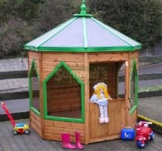 Octagonal Playhouse - use a patio umbrella with a stand for the roof and hinged plywood for the doors. One of the easiest DIY ideas for a playhouse I have seen, this is the closest picture example I have found (although it is not DIY)