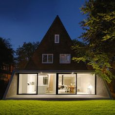 Building an inviting and impressive house is a complex project and one of the first steps is choosing the shape and the exterior look. An A-frame house is Amsterdam Houses, Doors And Floors, Dutch House, A Frame House, House Extensions, Open Plan Living, Cozy House, Ground Floor, Building A House