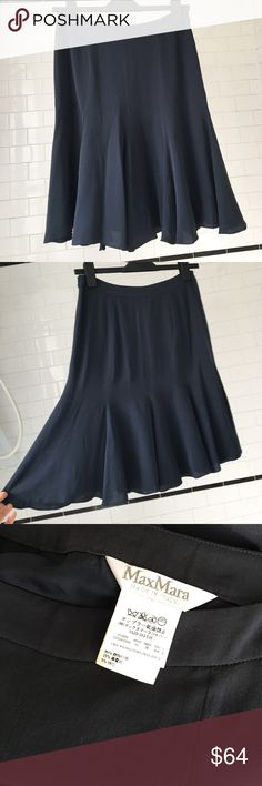 """MaxMara silk navy skirt This MaxMara silk skirt is a lovely navy. Only worn once or twice, in great condition. The size is an Italian 38, but I don't think this runs true to size. Flat measurement of the waist is 14.25"""". Made in Italy. Please let me know if you have any questions! MaxMara Skirts"""