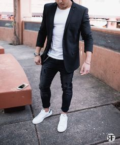 5852612bf1 Consider wearing a black sportcoat and black slim jeans for a dapper casual  get-up. Complete your look with white low top sneakers.