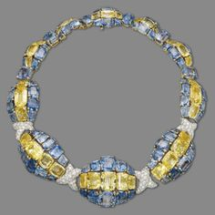 A Sapphire, Colored Sapphire and Diamond Necklace, by David Webb (Formerly the Property of Risë Stevens) – Composed of ten graduated oval-shaped bombé links, each centering upon a cushion-shaped yellow sapphire line, between vari-cut sapphire lines with pavé-set diamond cross-shaped links at the front, mounted in platinum and gold, 1958, inner circumference 39.0 cm, in grey velvet fitted David Webb case Signed Webb for David Webb
