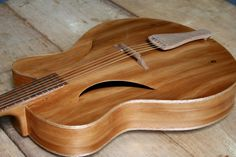 Another great design from Maxwell Custom Guitars where it showcases the soundholes which are carved in a fashion into the top. Acoustic Guitar Notes, Bass Guitar Chords, Classical Acoustic Guitar, Jazz Guitar, Music Guitar, Cool Guitar, Acoustic Guitars, Guitar Diy, Archtop Guitar