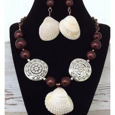 """This 20"""" Matagorda shell creation is reminiscent of the beautiful warmth and natural beauty of the Texas Gulf coast. Handmade with warm-hued copper and silver with a dash of elegant chocolatey-velvet  glass beads.  SOLD"""
