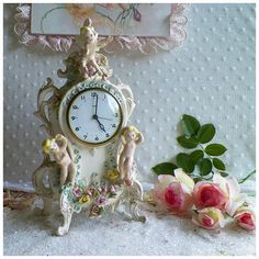 Vintage Lux Porcelain Cherub Rococo Mantle Clock. I bought this last Sept from Rose PetalsandBlooms.