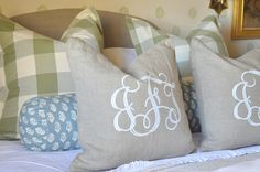 Monogrammed pillows. Love these colors, prints, and textures too.