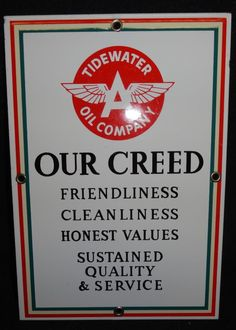 Sign for Flying A Tidewater Oil Company displaying Our Creed: Friendliness, Cleanliness, Honest Values, Sustained Quality & Service.