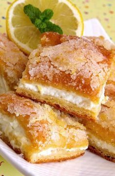 Looking for a rich, buttery dessert that's full of lemon flavor? Here's one spectacular dessert that will get you salivating and those taste buds fully satisfied! Thanks to AllRecipes, these Lemon Cream Cheese Bars are the perfect remedy for your dessert Lemon Desserts, Köstliche Desserts, Dessert Recipes, Brownie Desserts, Cheesecake Cookies, Lemon Cake Cookies, Baklava Cheesecake, Unique Desserts, Lemon Cupcakes