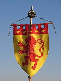 As before, an image of a Lion on a pennant like this (but with just a forward-facing head of Aslan, for instance) to not only remind people of the Narnia theme but also give a castley, medieval vibe