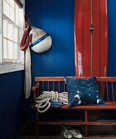 A well-worn nautical nook goes patriotic with a deeper hue of blue. | Spinnaker (RL1927), Harbor Blues Lifestyle Palette, @RalphLaurenHome Paint at The Home Depot