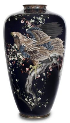 A large and impressive cloisonné enamel vase By Goto, Meiji period (late 19th century) Of baluster form worked in polychrome enamels and silver wire, in standard and musen cloisonné, decorated with a painterly design of large hawk perched upon a blossoming prunus branch on a midnight blue ground, the neck and foot decorated with a lappet band, gilt copper mounts, signed in archaic seal form Goto 37.5in (95.3cm) high. Sold Bonhams 2013 for $42,500.