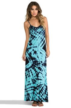 Woman in a Casual Turquoise & Black Psychedelic Print Pattern Dress.
