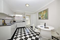 We love the Black and White Checkered floor in this recently styled Kitchen. #black #stylishKitchens #propertystylng #instantinteriors
