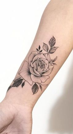Rose tattoo is such a wonderful idea for all the women in the world if they want to have a floral tattoo. The reason is because the rose flower is gorgeous and Mini Tattoos, Foot Tattoos, Body Art Tattoos, Small Tattoos, Sleeve Tattoos, Tatoos, Tattoo Femeninos, Rose Tattoo Forearm, Piercing Tattoo