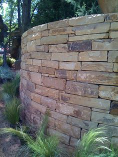 Benefits of Dry-Laid Stone Retaining Walls: Resists fire, water and insects Eco-friendly, does not deplete natural resources and can be re-cycled due to dry-laid method Drains naturally without damage, mortared walls tend to crack and break out large sections Aesthetically compliments most any landscape