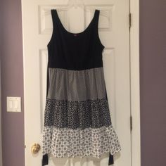 Black & White Tiered Sundress Great sundress for summer. I always receive so many compliments on this dress. Love that is ties in the back. Very flattering with the tiered pattern. Bought at Target a few summers ago. A size 1 according to their plus sizing. Pure Energy Dresses Midi