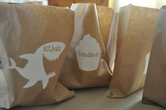decorate loot bags: cut out labels in fun shapes to decorate brown lunch bags.  Even easier if you buy the stickers.  Would you?