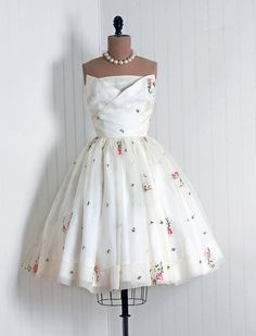 Party Dress: 1950's, embroidered floral silk organza, rhinestone embellished petal bust, tulle-lined skirt.