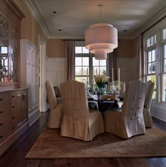 no pictures - wainscoating is architectural element -traditional dining room by Tina Barclay