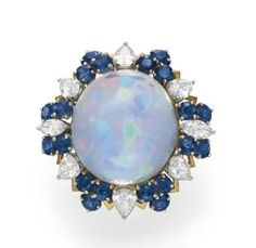 AN OPAL AND SAPPHIRE RING, BY FLATO