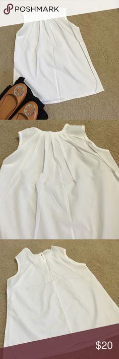 Price drop! NWOT white, sleeveless blouse White, sleeveless blouse with pleating on the top-front of the shirt. New without tags and only tried on once. Button closure on back of neck. Looser fit but true to size in length and arm holes. It is sheer as shown in photo. No trades. Tops Blouses