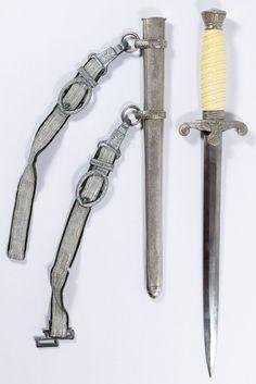 "Lot 355: World War II German Officer Dagger ; Having a ""Soligen"" mark on the blade, the original scabbard and hanger straps"