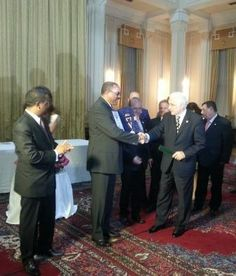 Academician Mircea Constantinescu from European Tourism Academy gives the insignia of the Academy to Prime Minister Hailemariam Desalegn