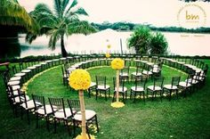 Why not create a circular, snail-shaped aisle. That way all your guests get a good look at you as you walk down the aisle, and you'll say your vows in the centre of all your friends and family.