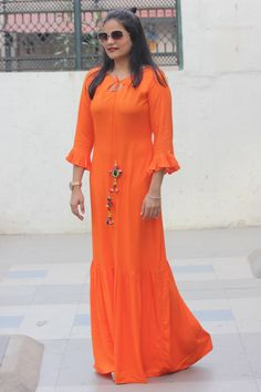 df86d93407c3e1 HJ 95Orange rayon pleated dress with tasselsMaterial- rayonPrice-  1900Length- 58 inches.Sizes