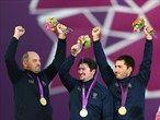 Gold medalists Michele Frangilli, Marco Galiazzo and Mauro Nespoli of Italy