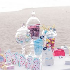 For a candy table, but more expansive with different  apothecary  jars filled with assorted candies and white chocolate dipped pretzel sticks with the shabby chic candlesticks mixed in.