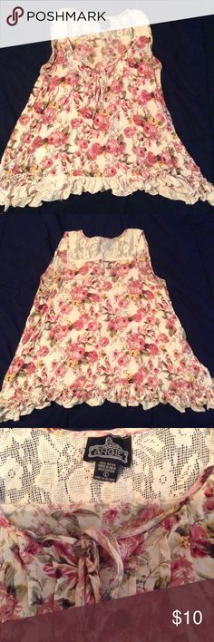 Floral Sleeveless Top  Floral sleeveless top which ties at the top. Lace detail at the bottom. Tops Tank Tops