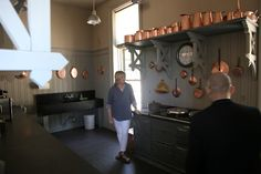 Here I am describing the stable kitchen, where my collection of copper pots is kept. Martha Stewart