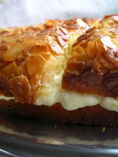 Bienenstich or Bee sting cake is a German dessert popular in Australia, made of a sweet yeast dough with a baked-on topping of caramelized almonds and filled with a vanilla custard, Buttercream or cream.  The cake may have earned its name from its honey topping: according to one legend, a bee was attracted to it, and the baker who invented the cake was stung.