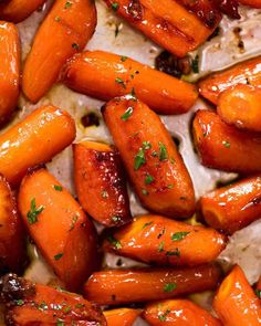 Brown Sugar Glazed Carrots - - Recipe video above. The most amazing quick and easy roasted carrots! Roasting brings out the best in carrots, always. And the caramelised edges are the BEST - it's the only way I make Glazed Carrots! Glazed Carrots Oven, Brown Sugar Roasted Carrots, Roasted Baby Carrots, Honey Glazed Carrots, Candied Carrots, Baked Carrots, Cooking Carrots In Oven, Glazed Carrots Recipe Easy, Pumpkins