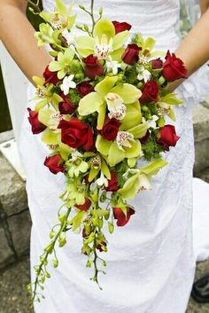 Cascading Bridal Bouquet: Red Spray Roses, White Stephanotis, Several Varieties Of Lime Green Orchids, Green Hypericum Berries
