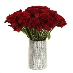 Beautiful red roses in a dotted Tom Budzak vase!