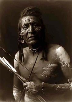 An Indian holding a Bow and Arrow  by edward s. curtis