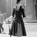 1950s:the Housewife Era:this decade fashion was influenced by the actress Audrey Hepburn.This photo she is wearing mid length dresses,light colors,fitted tops with pearls,poodle skirts.
